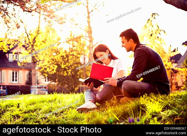 Students changing ideas learning for exam together in a city park. Students Brainstorming Meeting learning for exam. Fast learning concept