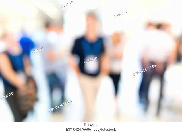Abstract blurred people socializing during coffee break at business meeting or conference