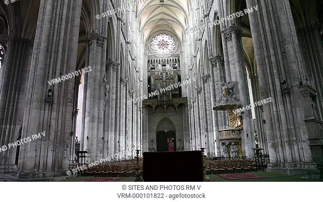 TILT up. LS. Interior: Nave looking west, organ and rose window above the west entrance, vaulted ceiling of the nave. The Cathedral is in the High Gothic or...