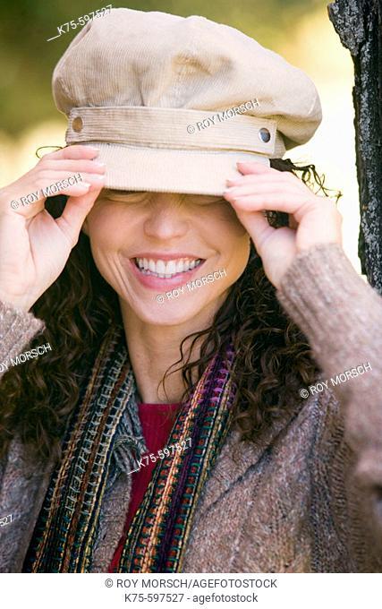 Woman adjusting her hat