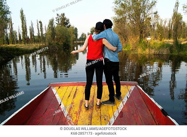 A couple on a boat in the canals of Xochimilco, Mexico City, Mexico