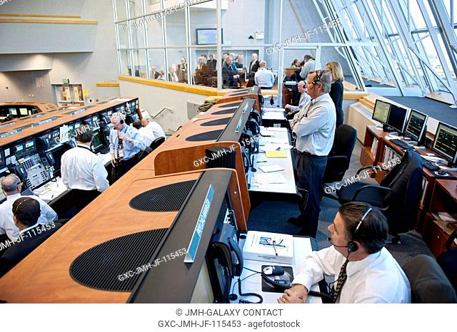 In Firing Room 4 of the Launch Control Center at NASA's Kennedy Space Center in Florida, the launch team monitors the countdown to launch of space shuttle...