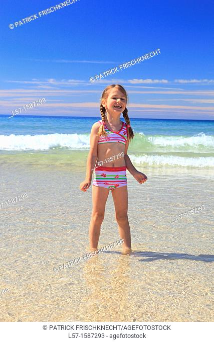 girl playing on sandy beach, Sutherland, Scotland