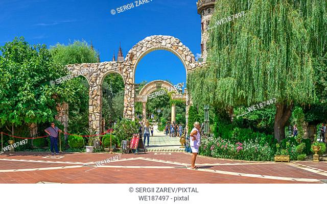 "Ravadinovo, Bulgaria â. "" 07. 11. 2019. Arched gate in the park of Ravadinovo castle, Bulgaria, on a summer sunny day"