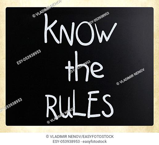 """""""""""Know the rules"""" handwritten with white chalk on a blackboard"
