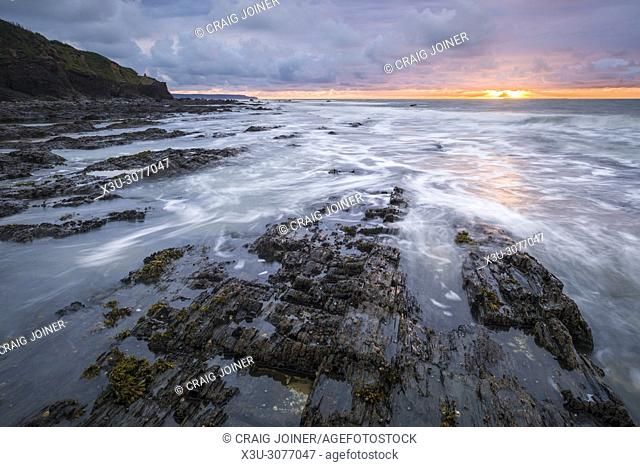 Sunset over the rocky shore at Westward Ho, North Devon, England