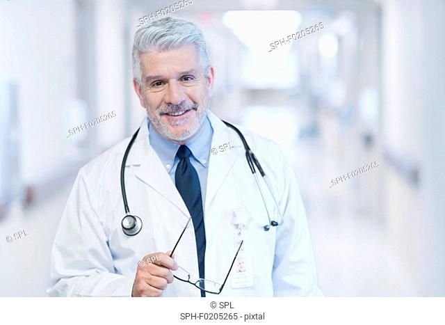 Mature male doctor smiling towards camera