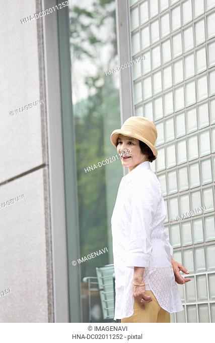 Senior woman turning round