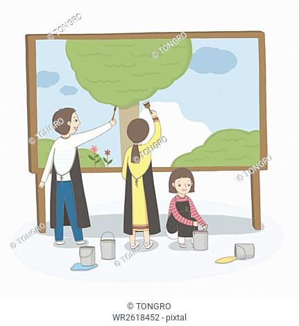 Smiling children painting picture