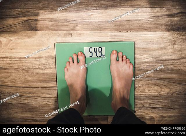Close-up of woman standing on scales