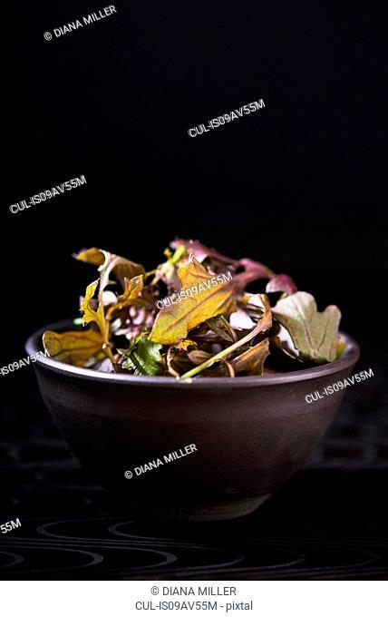 Salad leaves in brown dish