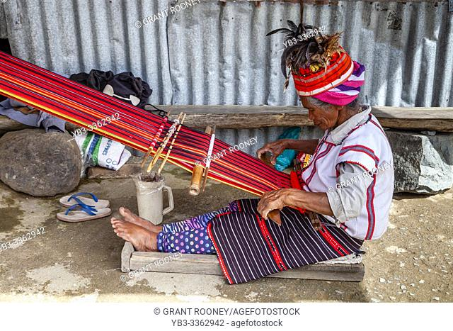 An Ifugao Tribal Woman Weaving Traditional Patterned Cloth, Banaue, Luzon, The Philippines