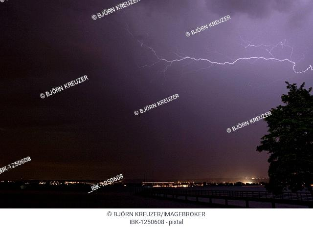 Lightning, cloud-to-cloud lightning, thunderstorm over Lake Constance and the skyline of Konstanz at night, Baden-Wuerttemberg, Germany, Europe