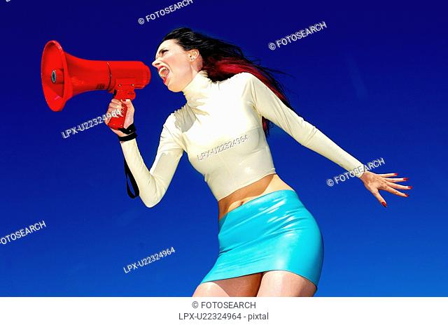 Side view of a woman with a megaphone