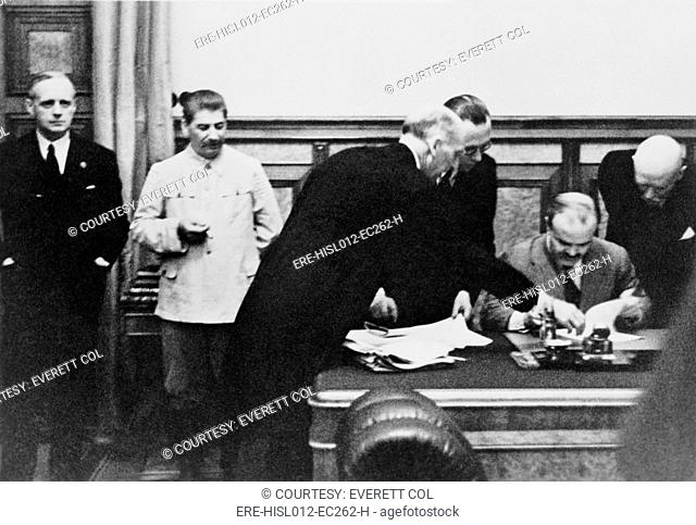 Soviet Foreign Minister Molotov signs the Nazi-Soviet Nonaggression Pact in the Kremlin on August 23, 1939. Left to right: Von Ribbentrop, Stalin, Gauss, Hilger