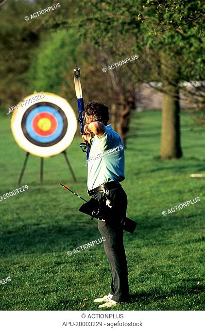 Male archer taking aim at a target