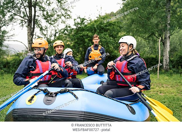 Group of friends preparing for a rafting trip
