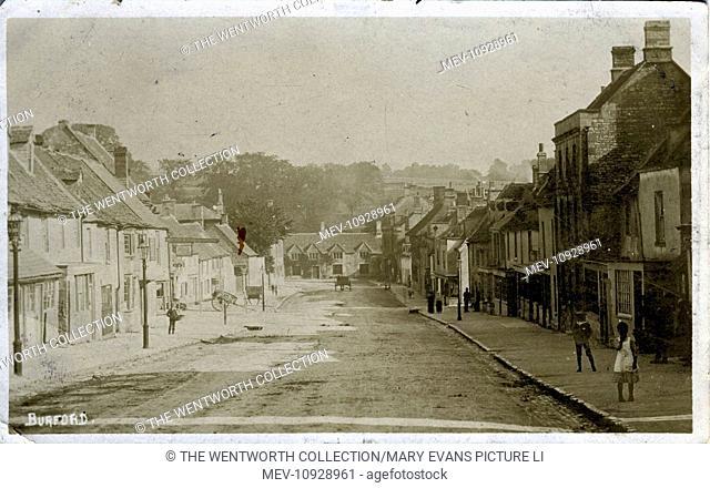 The Village, Burford, Oxford, near Witney, Oxfordshire, England. Showing Shop/Premises of WM Harvey