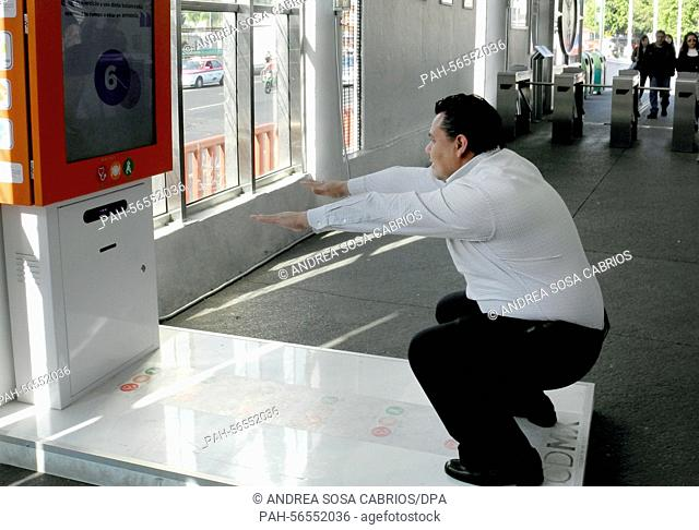 An obese man does knee-bends in front of a special fitness machine at a bus stop in Mexico City, Mexico, 19 February 2015