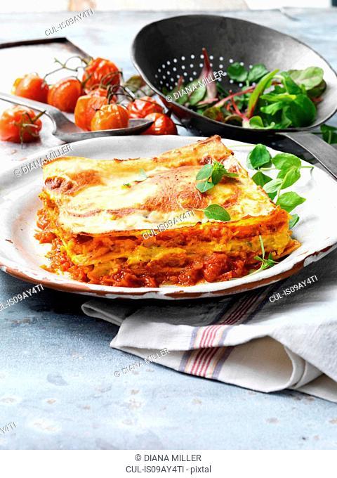 Food, vegetarian meals, roasted butternut squash lasagne, cheese, tomato, salad, vintage plate, rustic metal colander