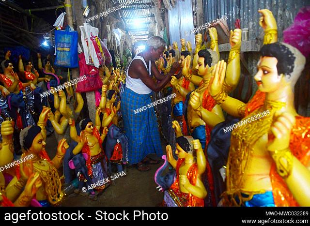 Idol makers are doing final touches and preparing the idols of Lord Vishwakarma for sale on the eve of the Vishwakarma Puja (The worship of Lord Vishwakarma) an...