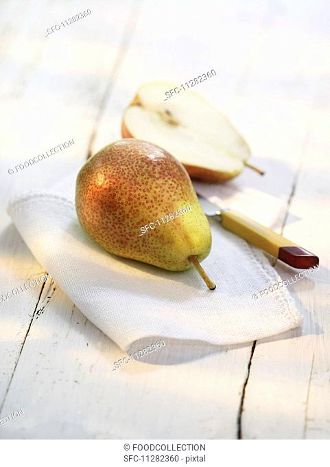 Pears on a cloth with a knife