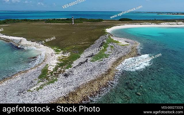 Aerial view of lighthouse of WATER CAY, ( CAYO DE AGUA) Caribbean sea. Fantastic landscape. Aerial view of paradise island bequeve with blue water