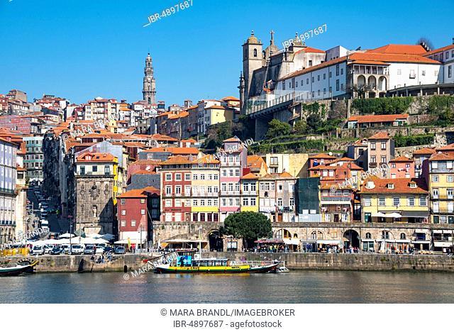 Historic old town Ribeira with church tower of the church Igreja dos Clérigos and Da Sé Cathedral, Cais da Ribeira, promenade at the Rio Douro, Porto