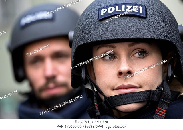 Two members of the German police present the new protective gear of the Bavarian police during a press conference held in Munich, Germany, 09 June 2017