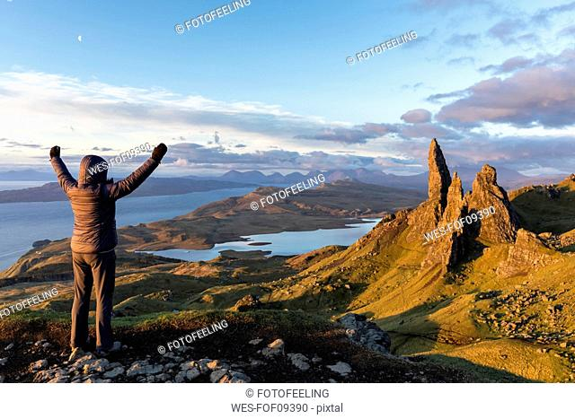 UK, Scotland, Inner Hebrides, Isle of Skye, Trotternish, tourist on peak near The Storr