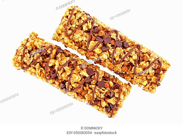 Chocolate cereal bars on white background, top view