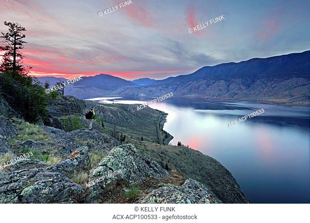 A photographer enjoys the sunset and views over the northwest end of Kamloops lake, Thompson Okanagan region, British Columbia, Canada