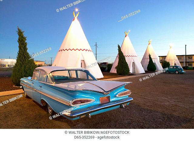 Wigwam motel concrete teepees and 1959 Chevrolet on Route 66 at evening. Holbrook. Arizona, USA