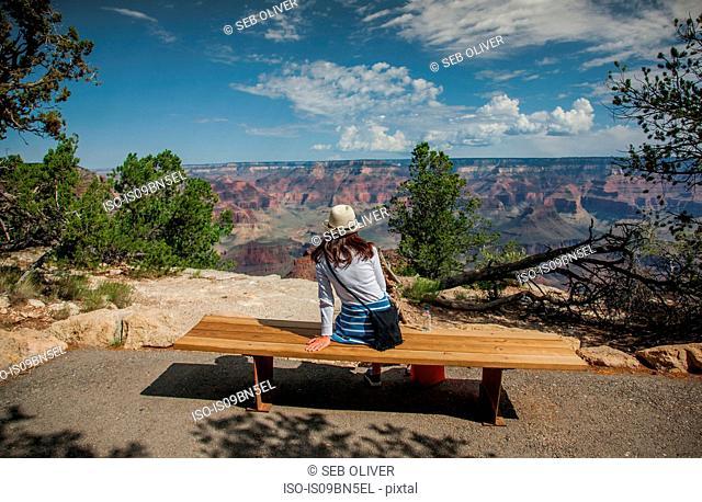 Tourist looking out at scenery, Grand Canyon, Arizona, USA