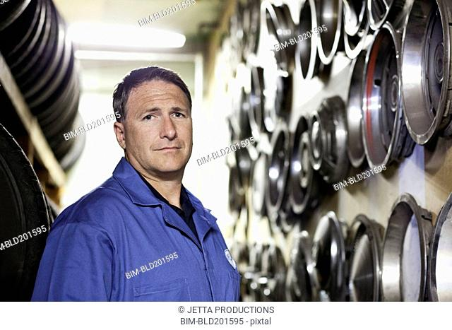 Caucasian worker in tire store