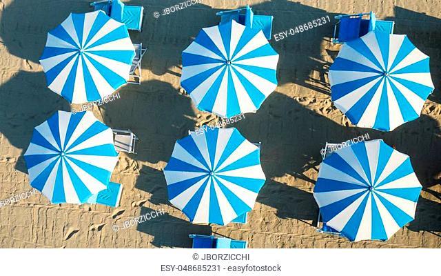 Bird's eye view of colored umbrella in a beach in italy, Tuscany, Viareggio