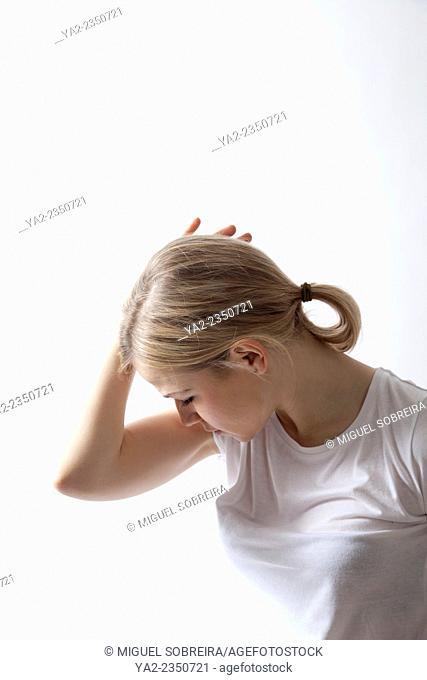Woman in T-shirt Touching Head