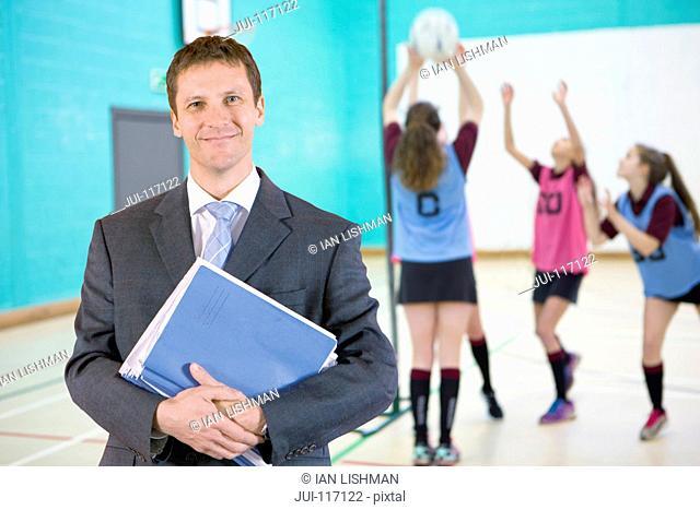 Portrait Of Teacher With Pupils Standing In Gymnasium