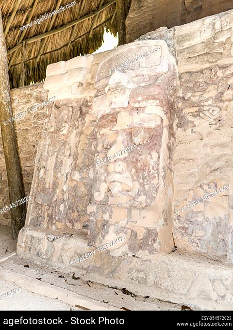 Well preserved statue on the Temple of the Masks at Kohunlich maya archaeological site in pre-Columbian Maya civilization, Yucatan Peninsula, Mexico