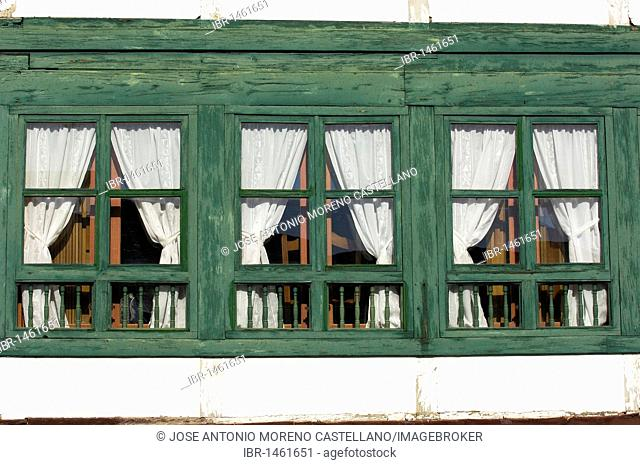 Windows of a house on Main Square dating from 13th century, Almagro, Ciudad Real province, Castilla-La Mancha, Spain, Europe