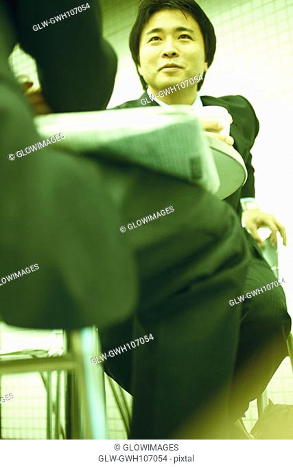 Low angle view of two businessmen sitting at a table