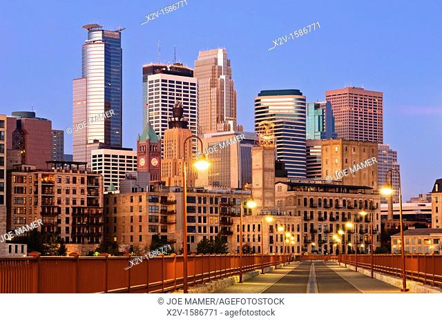 Minneapolis skyline at dawn as seen from the Stone Arch Bridge   The Stone Arch Bridge is a former railroad bridge crossing the Mississippi River at Saint...