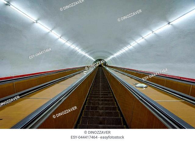 Long escalators and long tunnel to Yerevan metro, Armenia