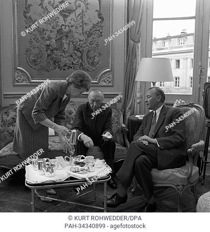 German chancellor Konrad Adenauer is having a coffee break with his son Max and his daughter Ria Reimers in their luxury appartment at the Quai d'Orsay in Paris...