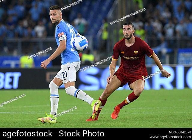 The Roma player Bryan Cristante and the Lazio player Sergej Milinkovic Savic during the Lazio-Roma match at the stadio Olimpico