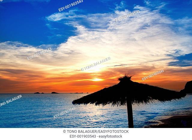 Ibiza sunset in cala Conta Conmte beach with sunroof backlight