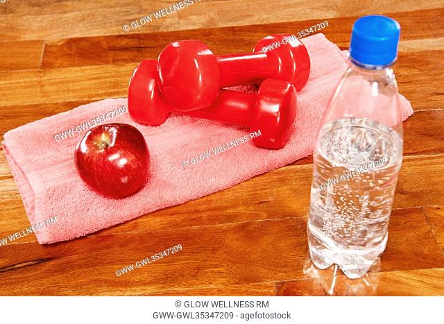 Water bottle with an apple and dumbbells
