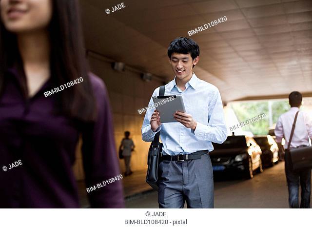 Chinese businessman using digital tablet