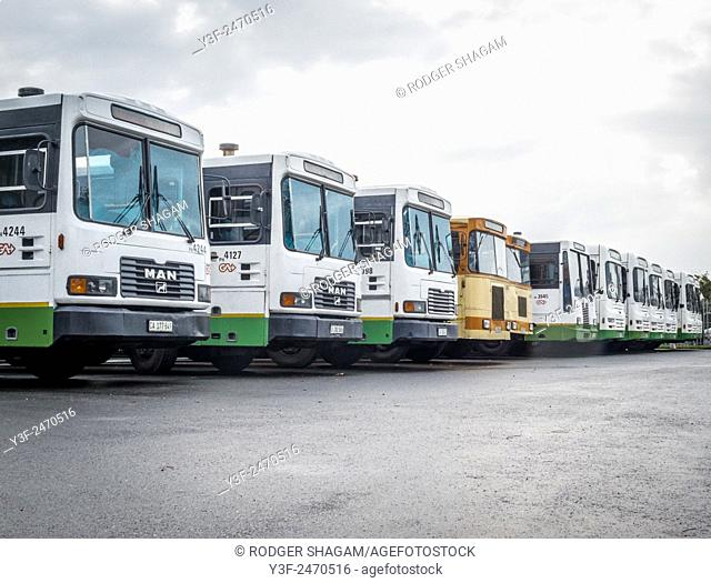 Busses parked in a row. End of the line. A bus terminus in Cape Town, South Africa