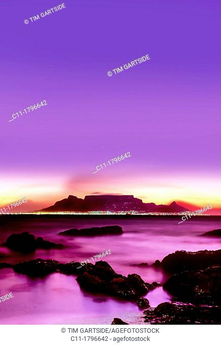cape town from bloubergstrand at dusk sunset showing lights ocean and beach